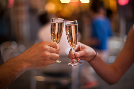 Photo pour Cheering with a glass of champagne - image libre de droit
