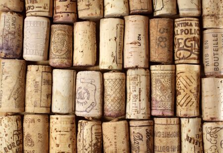 Background with many old corks of desk
