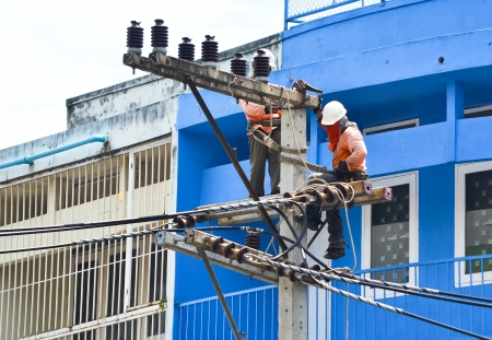 electrician working on electricity post
