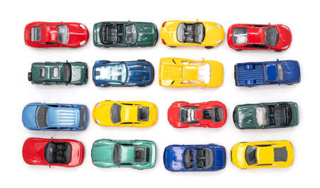Photo pour Toy cars in neat rows of the four primary colours - image libre de droit