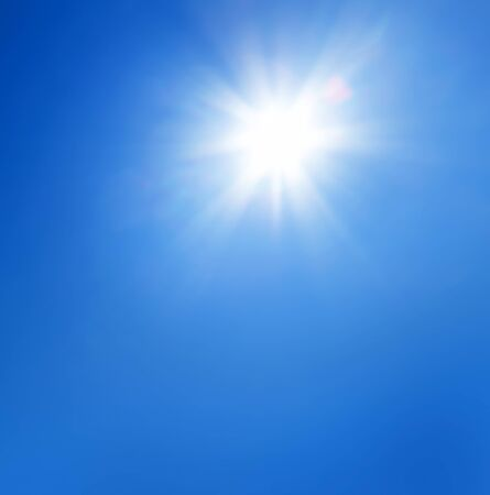 Sun with lens flare and blue sky background