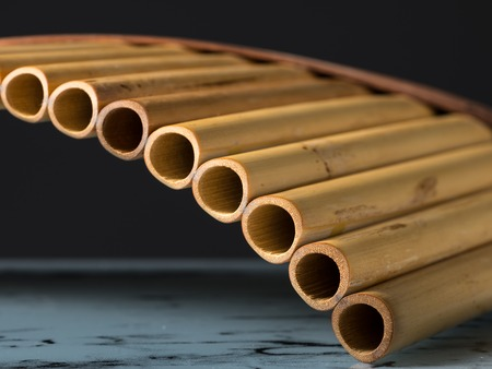 Photo pour Detailed closeup view of a pan flute, dark background - image libre de droit