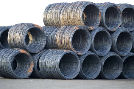 Stack of shiny cable wire rolls keep at construction site