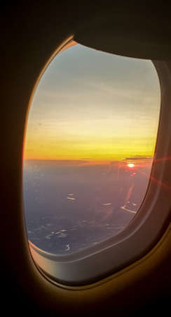 Aerial view from airplane window with the beautiful sky sunset