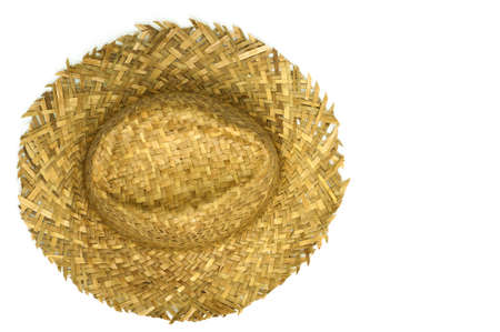 Top view of straw hat isolated on a white background