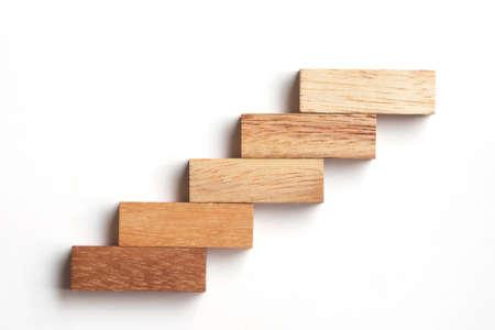 Photo pour Wood block stacking as step stair. Business concept for growth success process. - image libre de droit