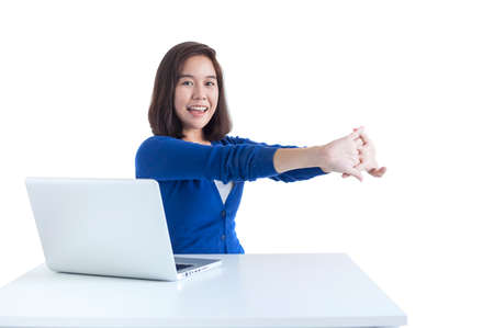Business woman do stretch with laptop in front isolated over white background.