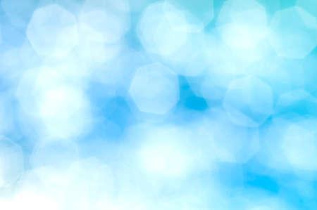 Blue hexagonal bokeh abstract background.