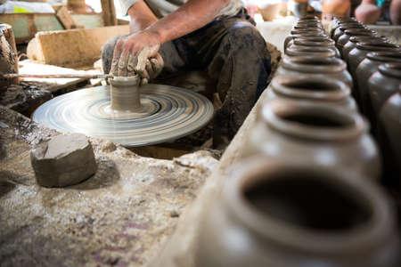 Photo pour Artisan hands making clay pot - image libre de droit
