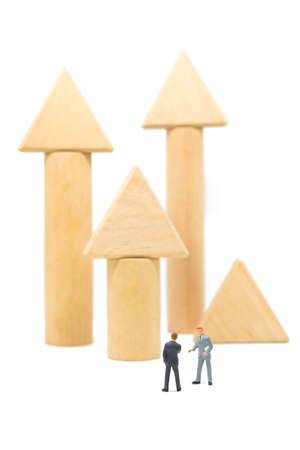 Business concept of success investment. Businessman standing whit advicer in front of wood arrow graph.