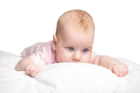 Photo for the little girl lies on a pillow - cloud. isolated on a white background. - Royalty Free Image