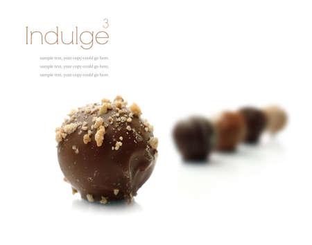 Photo pour Studio macro of assorted delicious liqueur chocolates on a white background with soft shadows - image libre de droit