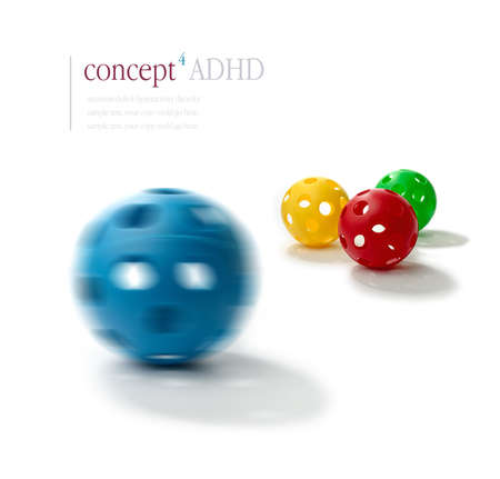 Concept image illustrating Attention Deficit Hyperactivity Disorder (ADHD). Spinning blue plastic ball with the illusion of two eyes and a mouth in foreground with normal balls in sharp relief in background. ADHD concept. Copy space.