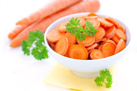 sliced carrots in bowl with parsley