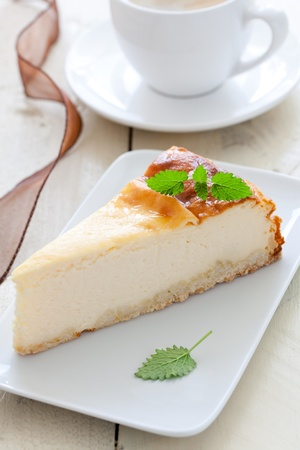 cheesecake with mint on plate