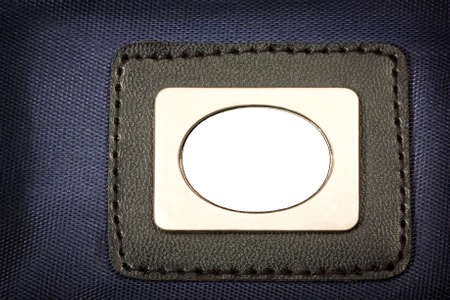 Metal Plate, with black border  inserted in blue fabric
