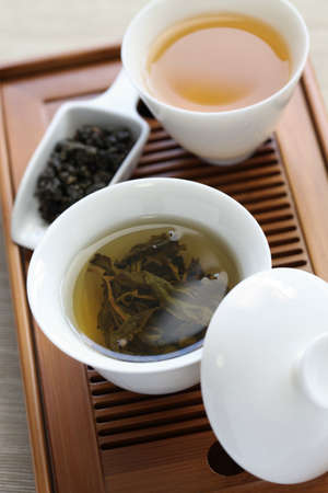 traditional chinese tea ceremony,oolong tea, gaiwan, tasting cup, bamboo tea tray