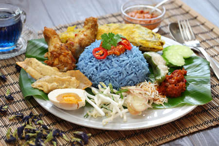nasi kerabu, blue color rice salad, traditional malaysian cuisine