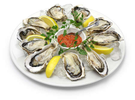 Foto de fresh oysters plate isolated on white background - Imagen libre de derechos