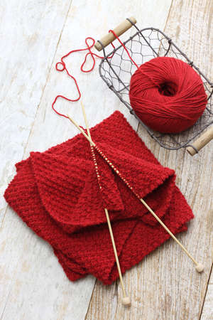 Photo pour hand knitted red scarf, yarn ball and knitting needles, handmade christmas present - image libre de droit