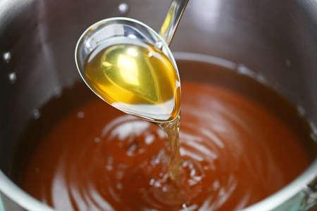 Photo pour making chicken consomme soup in a pot - image libre de droit