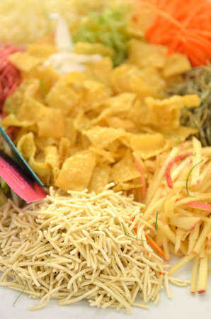 A special dish during Chinese New Year called Yusheng or Yee Sangの写真素材