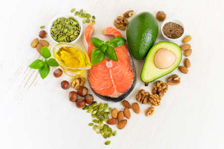 Foto de set of food with healthyl fats and omega-3, laid out in the shape of a heart. Health concept - Imagen libre de derechos
