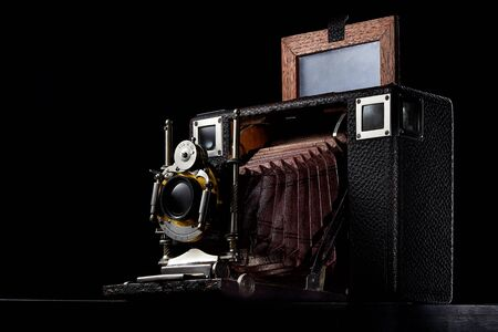 Photo for Old vintage wooden camera on a dark wooden background. Horizontal with a copy of the space. - Royalty Free Image