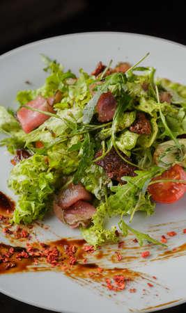 Photo pour Vegetable salad on a plate on a glass background - image libre de droit