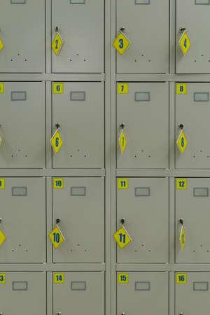 Photo pour Iron storage cells in a supermarket with protruding keys. - image libre de droit