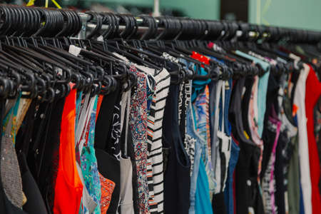 Photo pour Colorful clothes on hangers in a store. - image libre de droit