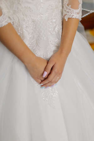 Photo for Young bride hands on a wedding dress - Royalty Free Image