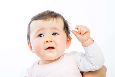 closeup of a cute baby on a white background