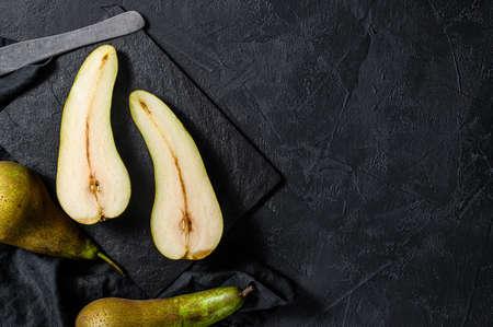 Foto für Pears and pear halves. Farm eco fruits. Black background. Top view. Space for text. - Lizenzfreies Bild