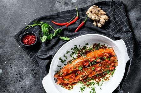 Photo pour Cooking sea trout fillet teriyaki. Black background. Top view. - image libre de droit
