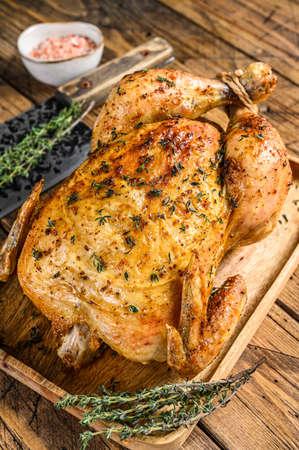 Photo pour Whole grilled chicken rotisserie. Wooden background. Top view - image libre de droit