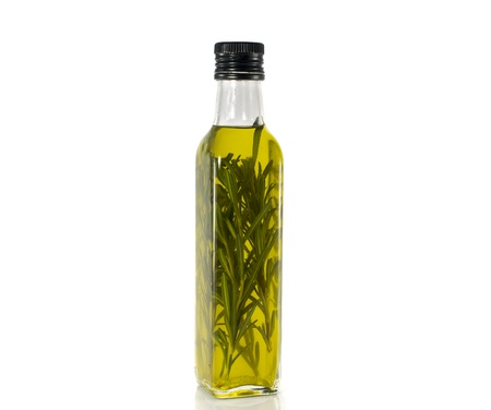bottle olive oil with oregano isoalted on white