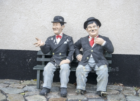 funny Laurel and hardy on a bench in garden