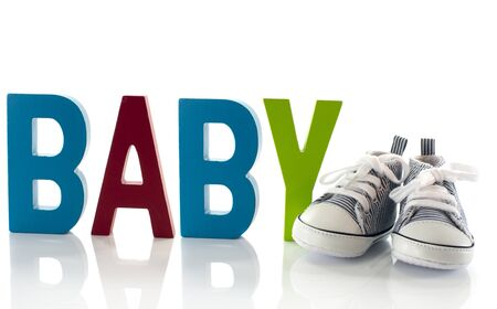 Photo for baby sport shoes with wooden text - Royalty Free Image
