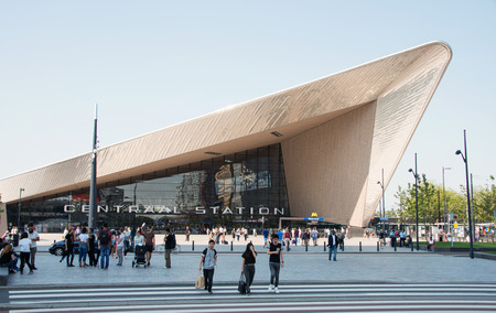 ROTTERDAM, NETHERLANDS - AUGUST 22 2015: City skyline and construction of Rotterdam Central Station, an important transport hub with 120000 passengers per day on August 22, 2015 in Rotterdam, Holland