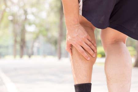 Foto de Cramp in leg while exercising. Sports injury concept - Imagen libre de derechos