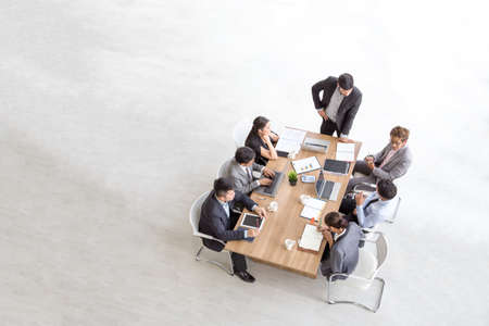Foto per Top view of group of multiethnic busy people working in an office, Aerial view with businessman and businesswoman sitting around a conference table with blank copy space, Business meeting concept - Immagine Royalty Free