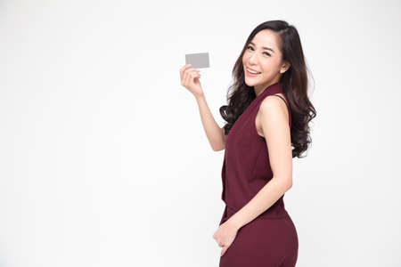 Photo for Asian woman presenting credit card in hand for making payment shopping isolated on white background - Royalty Free Image