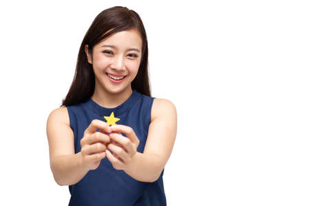 Foto de Happy Asian business woman showing star sign isolated on white background, Customer experience and best excellent services rating for satisfaction concept - Imagen libre de derechos