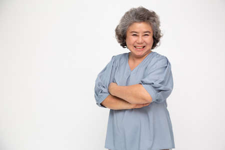 Foto per Portrait of asian senior women with arms crossed and smile isolated over white background, Mature smiling and looking at camera, Happy feeling concept - Immagine Royalty Free