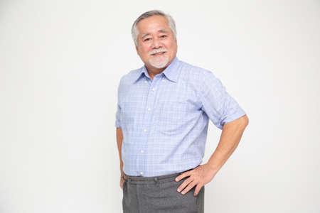 Foto de Portrait of senior asian man smile isolated over white background, Mature businessman smiling and looking at camera, Happy feeling concept - Imagen libre de derechos