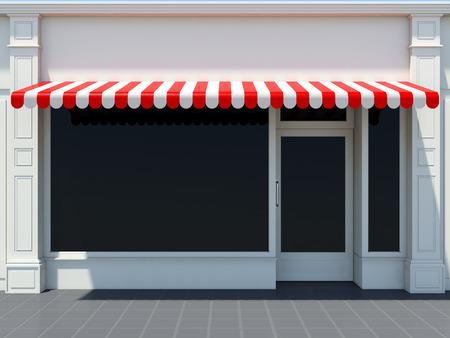 Foto de White shopfront in the sun - classic store front with red awnings - Imagen libre de derechos