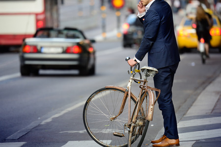 Man in perfect suit and old bike, typical Stockholm Scene