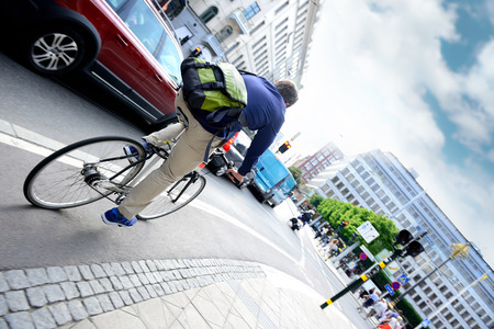 Man on bike in city traffic