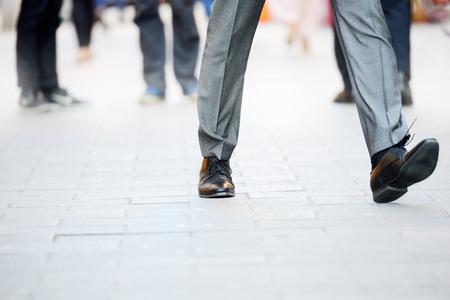 Photo pour Business man in suit taking a big fast step forward - image libre de droit